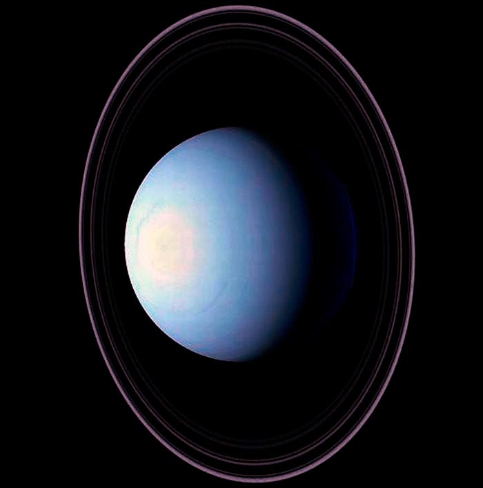 Планета Уран окруженная кольцами